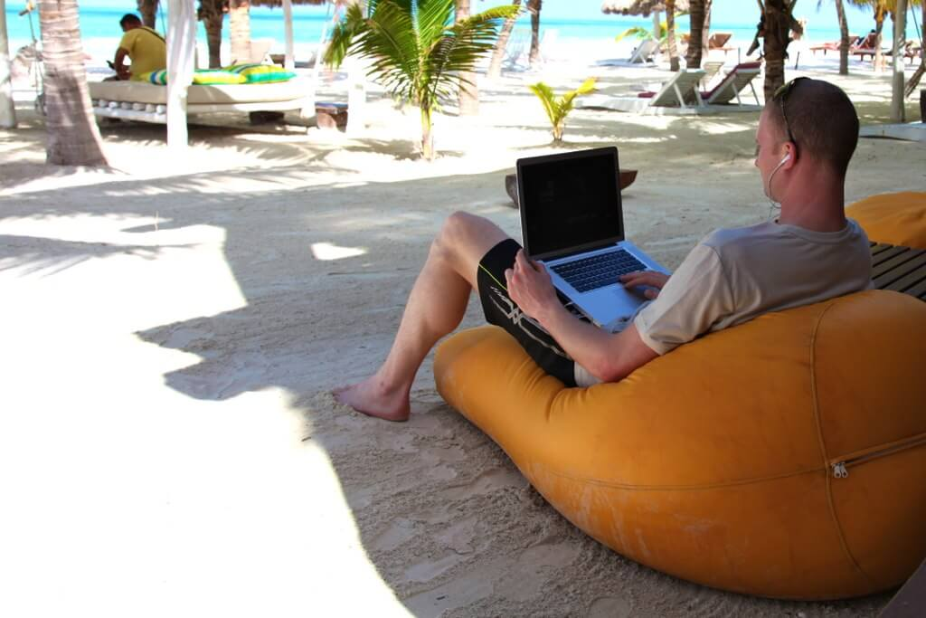 A Digital Nomad working at beach