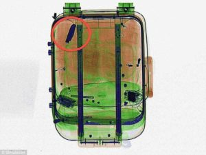 x ray image of baggage with metal knife inside