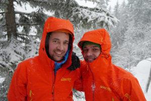 2 men wearing gore-tex jacket in snowy area