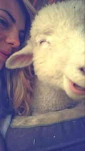 A woman and sheep laughing
