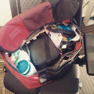 A fully packed timbuk2 messenger bag