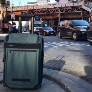 a roller suitcase on a road