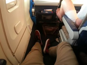 Leg rest space for a tall man in a plane