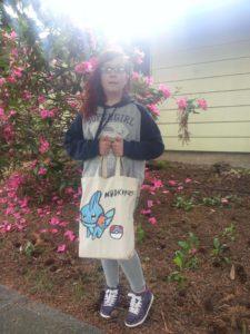 girl carrying travel tote bag