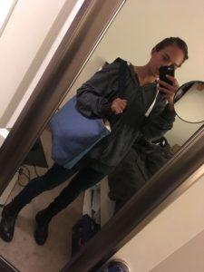 women carrying travel tote bag